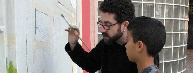 Artistas-del-imvg-brenan-pintando-carrusel